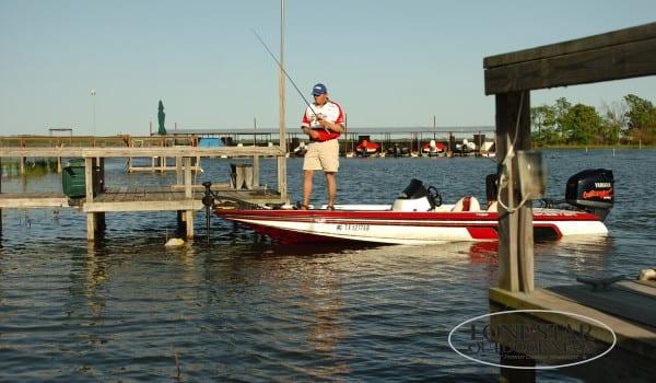 LARGEMOUTH BASS FISHING.Lance Vic, landing bedding  bass on lake fork texas