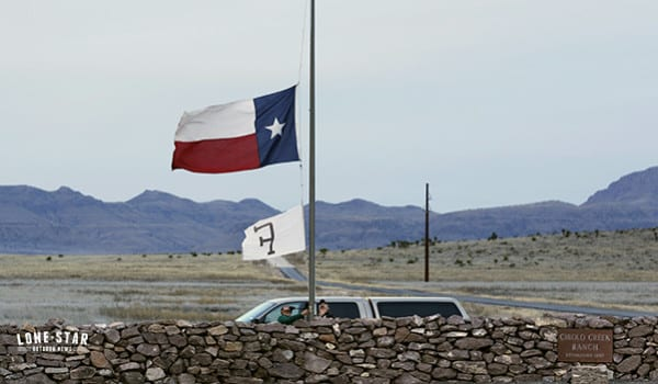 CIBOLO CREEK RANCH, TX - FEBRUARY 13, 2016 - Ranch staff lower the Texas and ranch flag to half staff at Cibolo Creek Ranch south of Marfa, Texas where Supreme Court Justice Antonin Scalia died Saturday. (Photo by Erich Schlegel)
