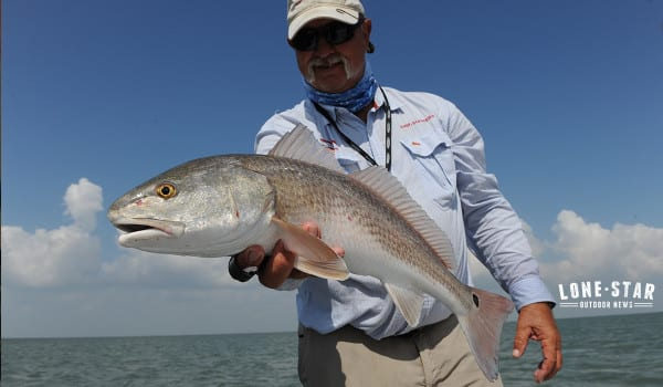 WHITE BASS..Dick Hart fishing on Cooper Lake Texas...elderly angler fish boat slap spoon jig