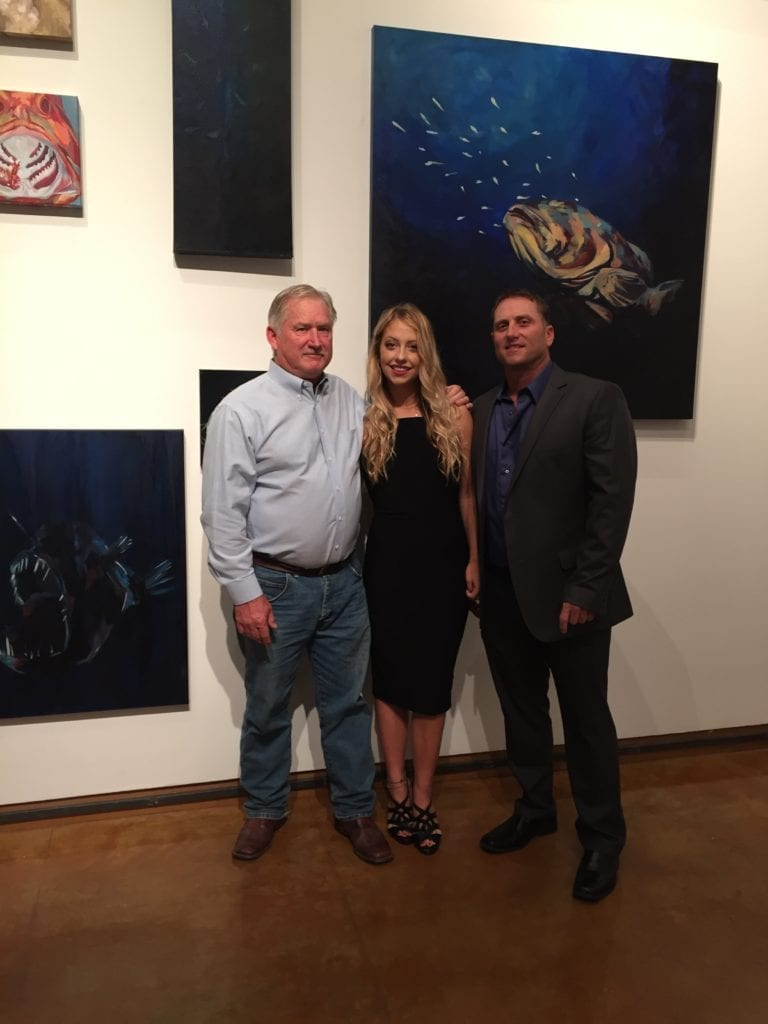 Brittney Drinkard won a $50,000 scholarship for her 7-pound, 4-ounce sheepshead in the CCA STAR tournament when she was 8 years old. Last December, she graduated from Lamar University with an art degree. At her thesis showing, she stood with her father, David Jr, and grandfather, noted wildlife artist David Drinkard. The showing focused on paintings of saltwater species. Photos from Brittney Drinkard.